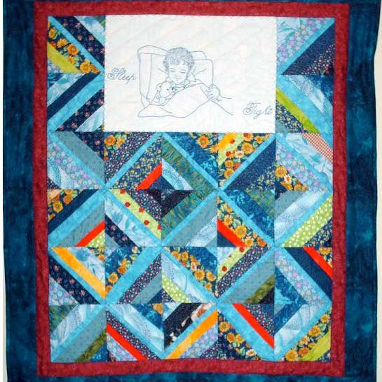 Baby blue quilt with embroidered sleeping child.