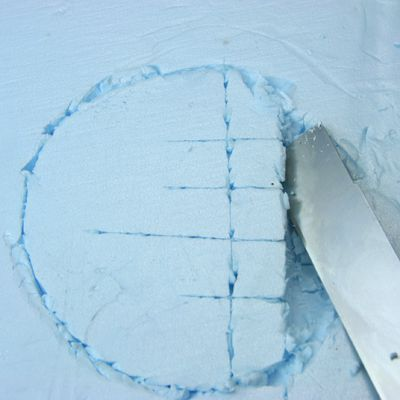 Carving a recess for a model pond in ridgid insulation foam board.