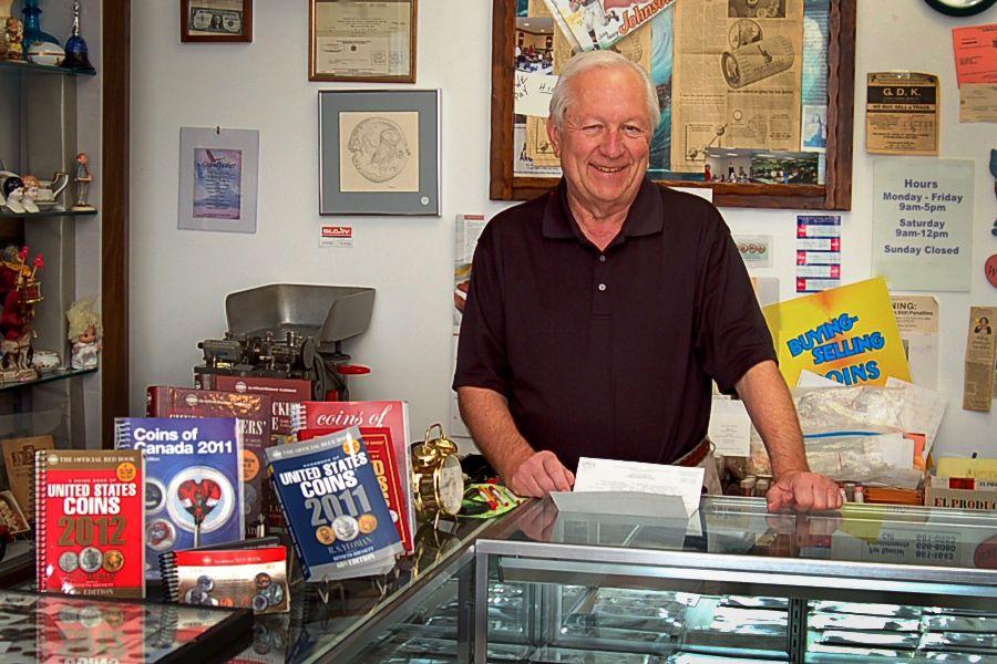 Coin Dealer in His Coin Shop