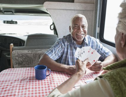 Two men playing cards at a table