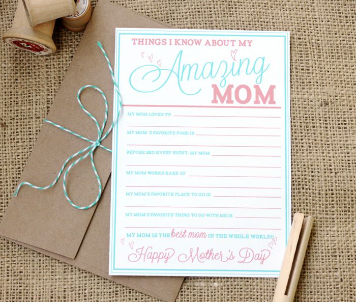 A blue and pink Mother's Day card on a table