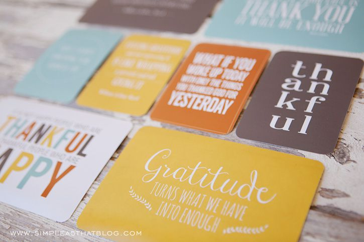 Thanksgiving quote cards laying on a table.