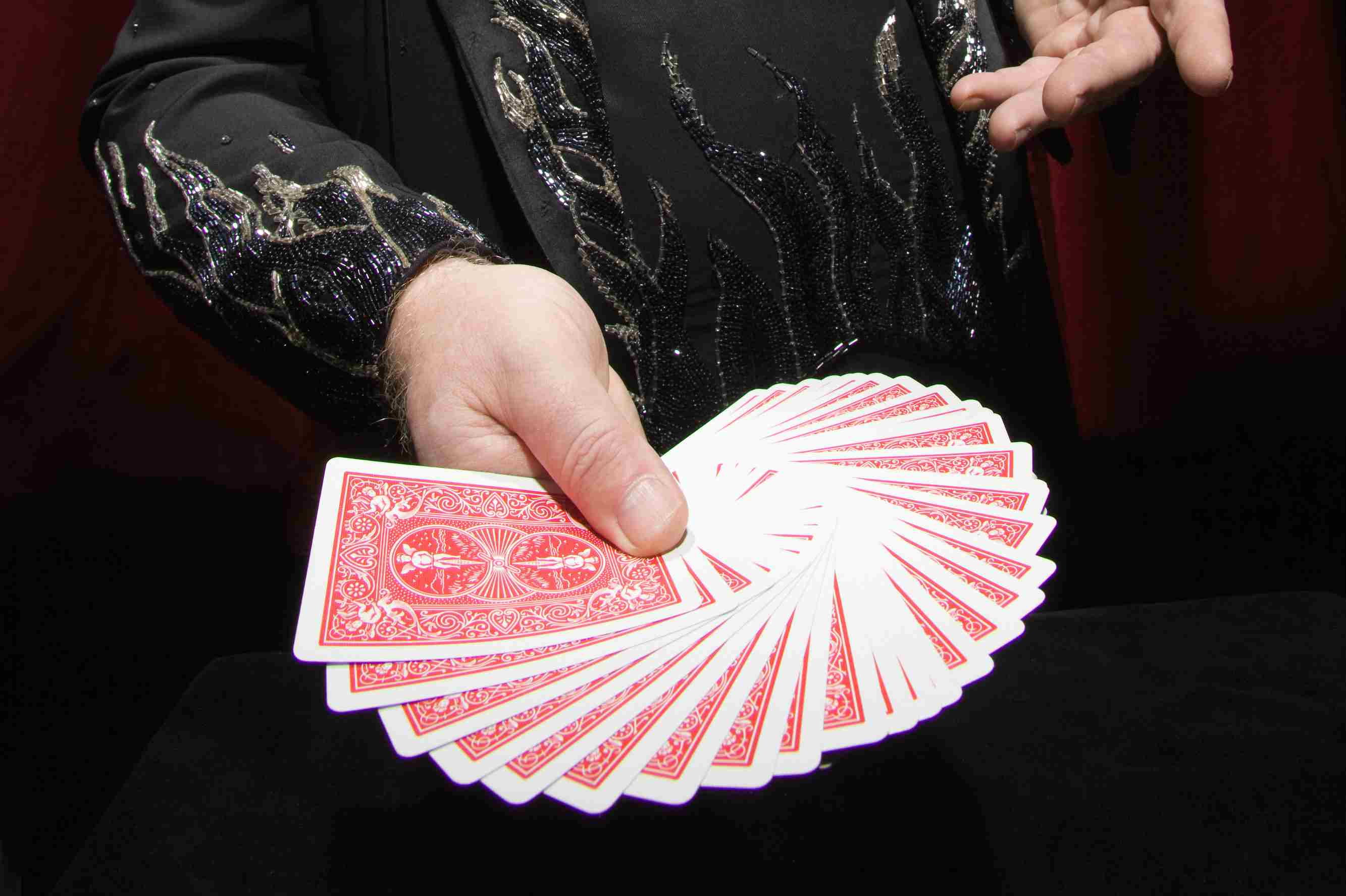 Magician fanning cards