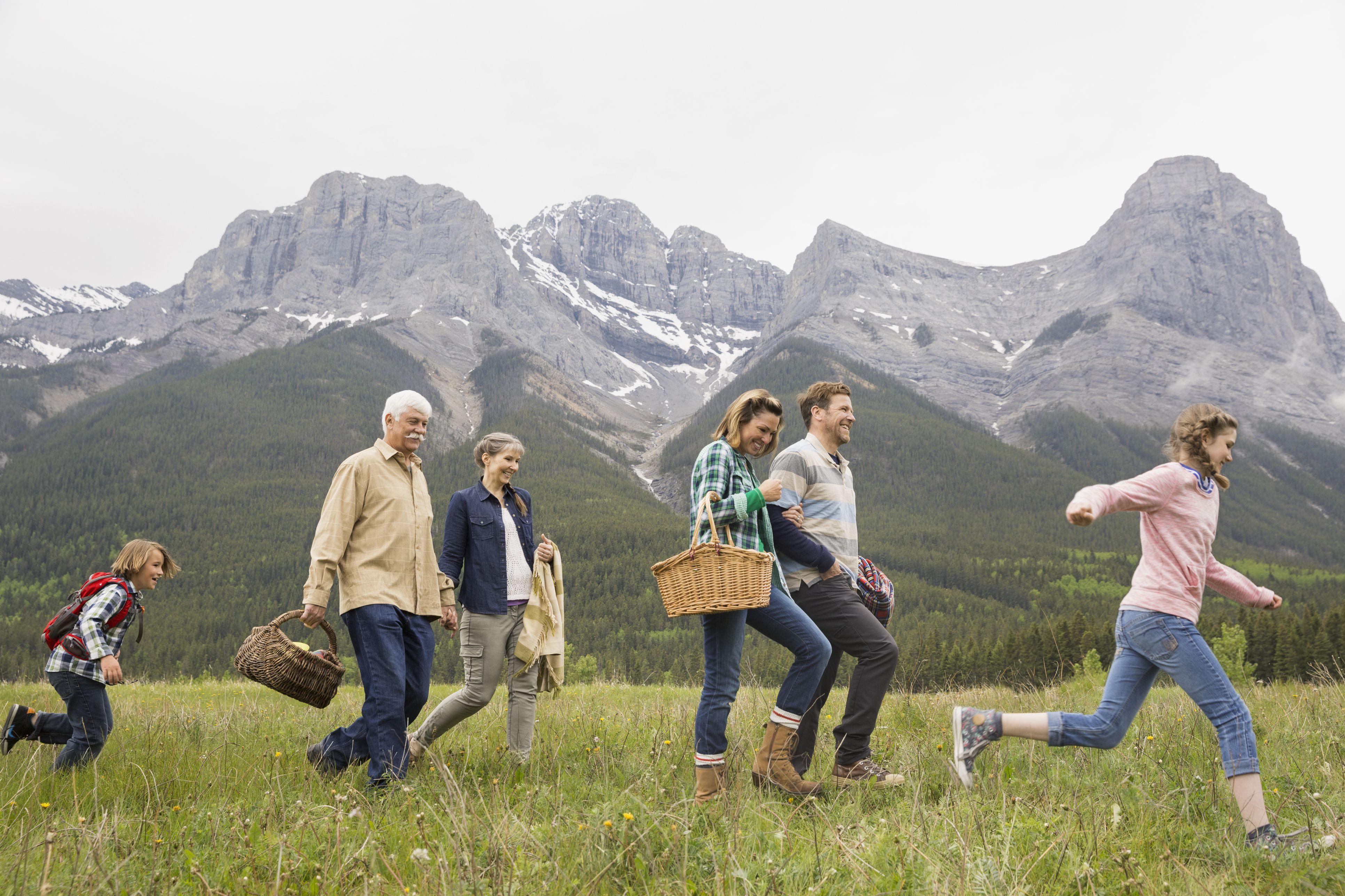 Family having picnic in rural field