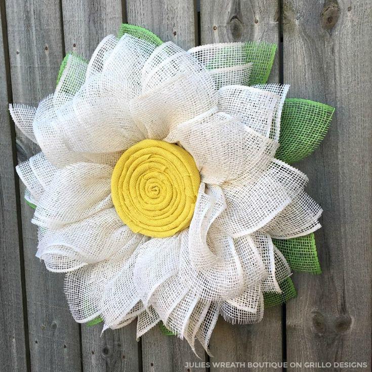 A daisy shaped wreath made of burlap
