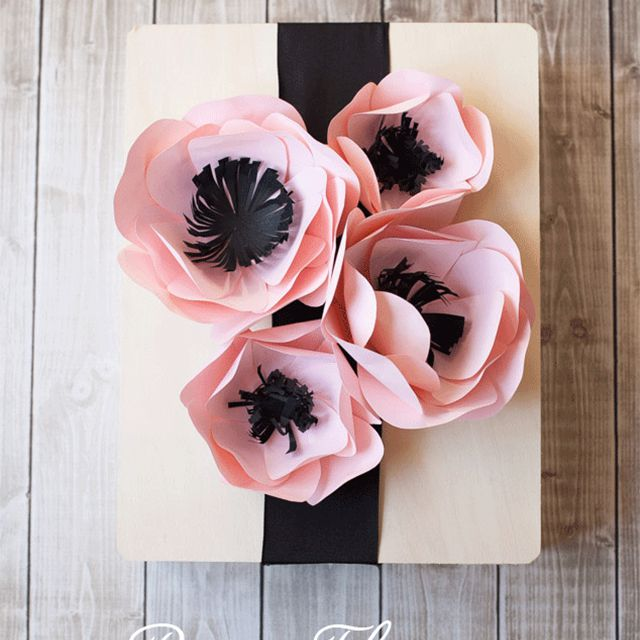 A group of pink paper anemones on a gift