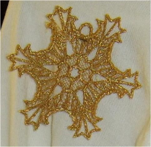 A lace snowflake sewn on a home embroidery machine