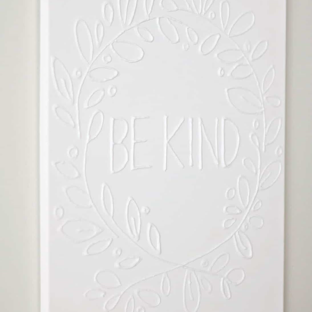 White wall art made with glue.