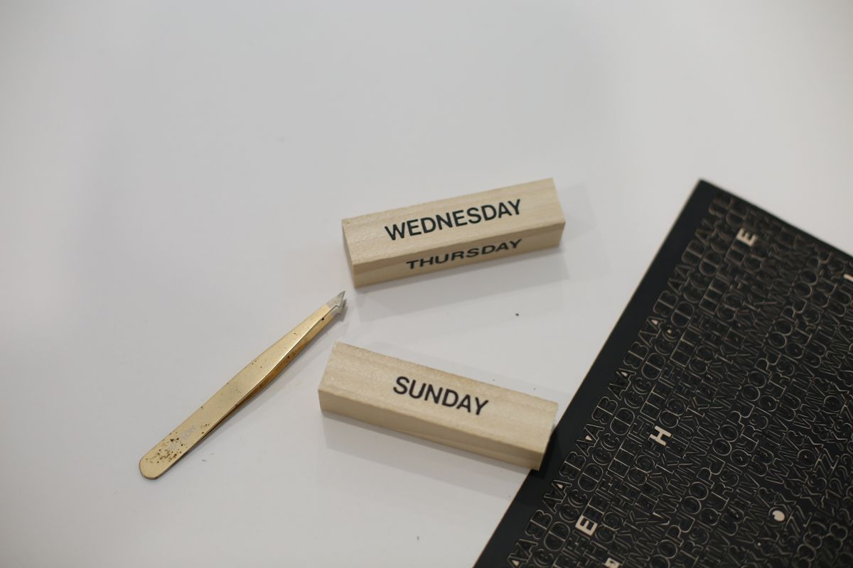 Wood blocks with stickers for the days of the week