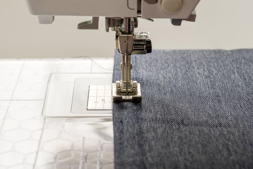 Close-Up Of Textile Being Stitched In Sewing Machine