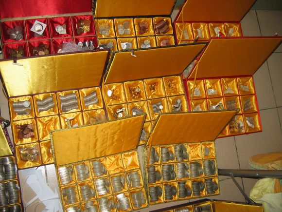 Counterfeit coins in boxes made by a major Chinese fake coin operation.