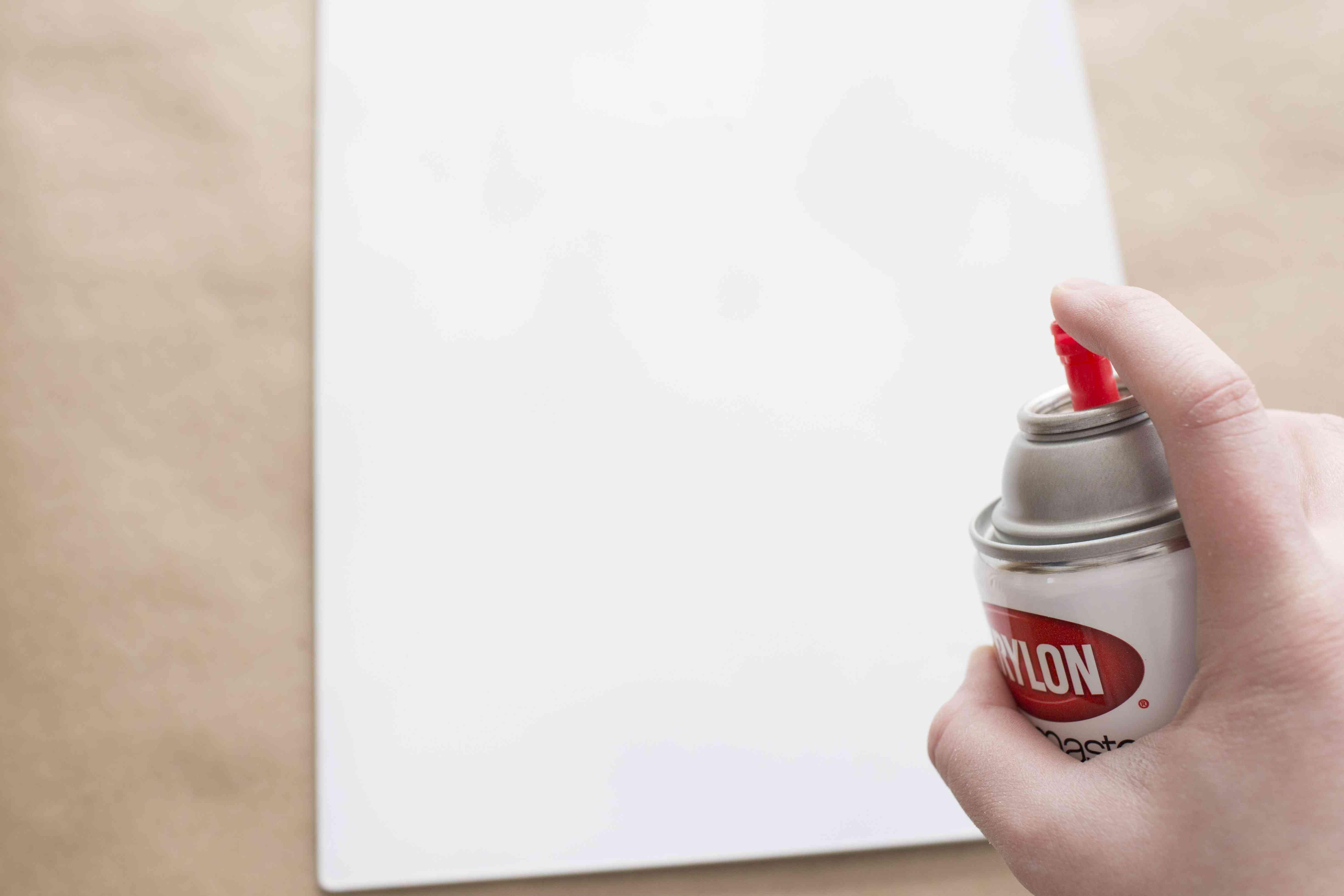 Spray painting a metal sheet white