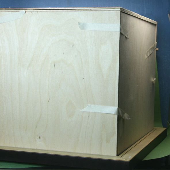 Plywood sides, top and floor of a simple roombox, test fitted by taping them together.