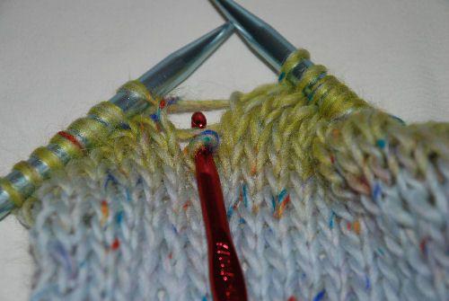 Using the crochet hook.