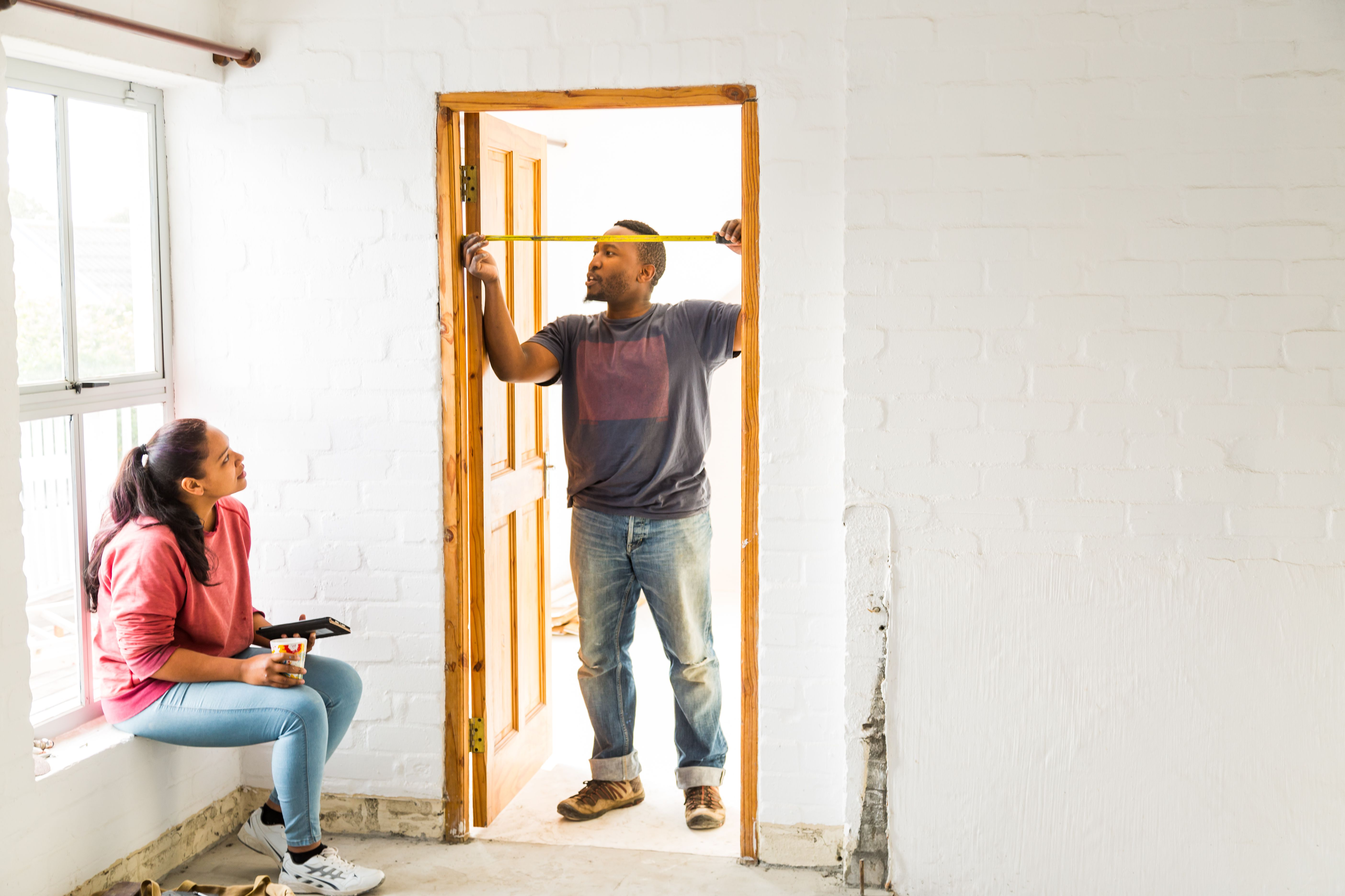 man measuring door frame