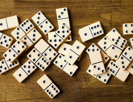 Domino tiles on wooden surface