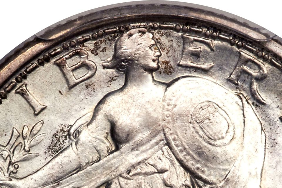 1916 Standing Liberty Quarter close-up with Liberty's right breast exposed