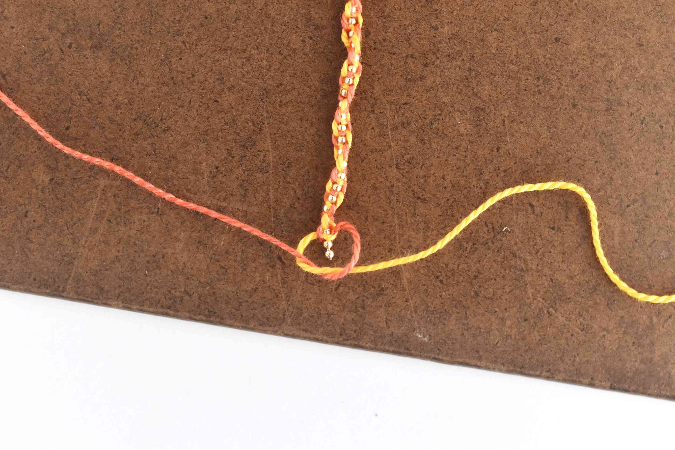Tie a Square Knot at the End of the Bracelet