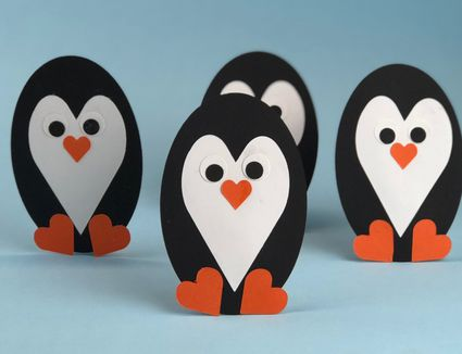 group of paper penguins