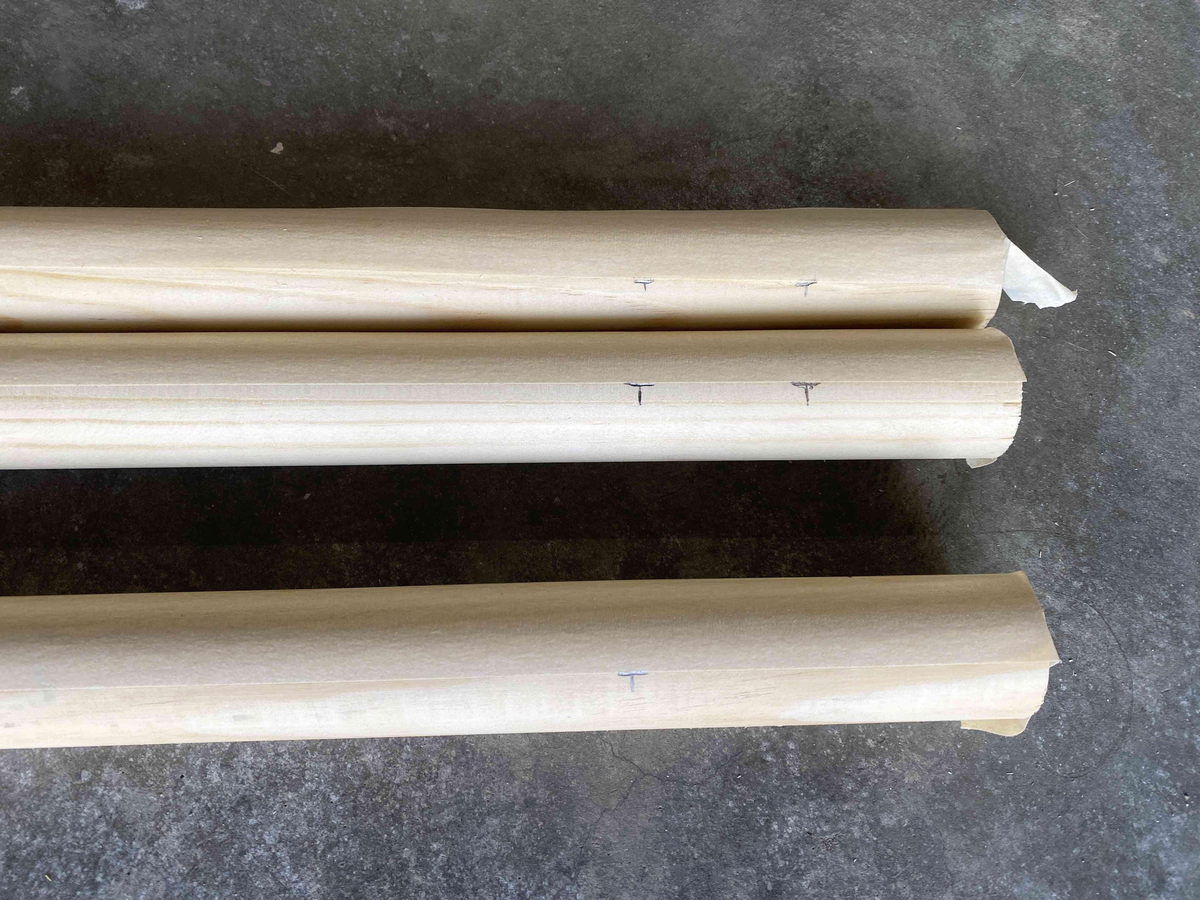Three dowel rods marked