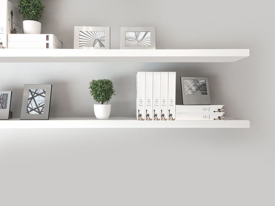A set of gray bookshelves