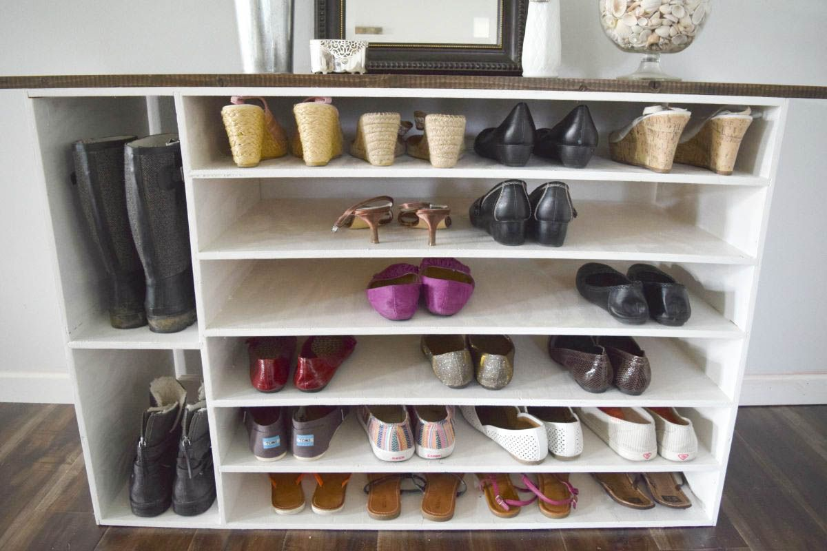 A shoe rack with different sizes of shoes