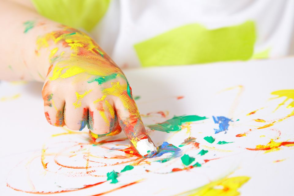 A child's hand finger painting