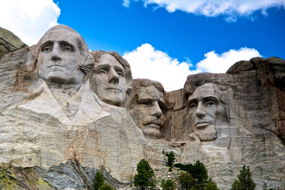 mount rushmore in front of blue sky