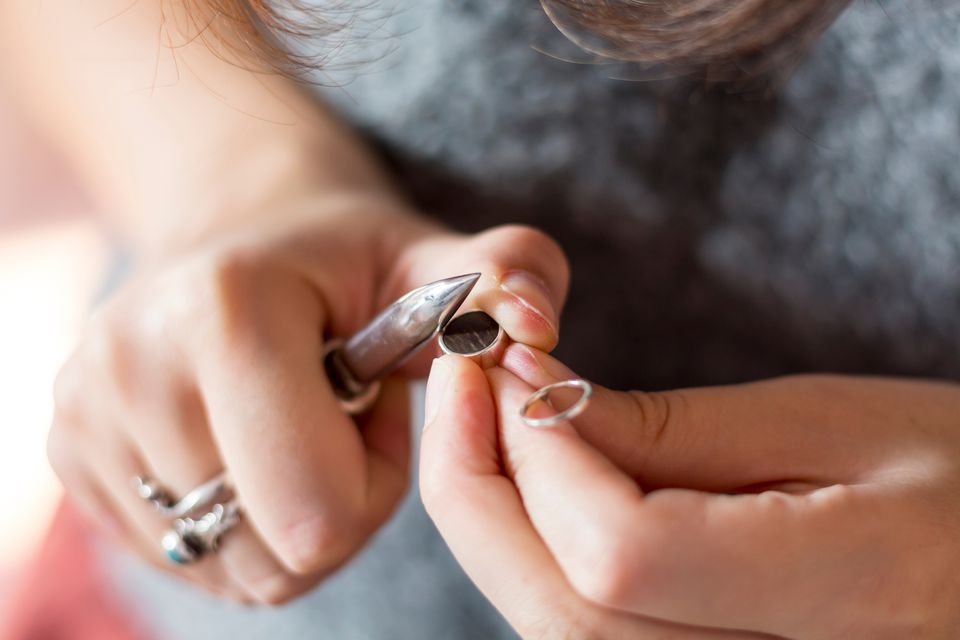 Midsection Of Woman Inserting Wood In Ring