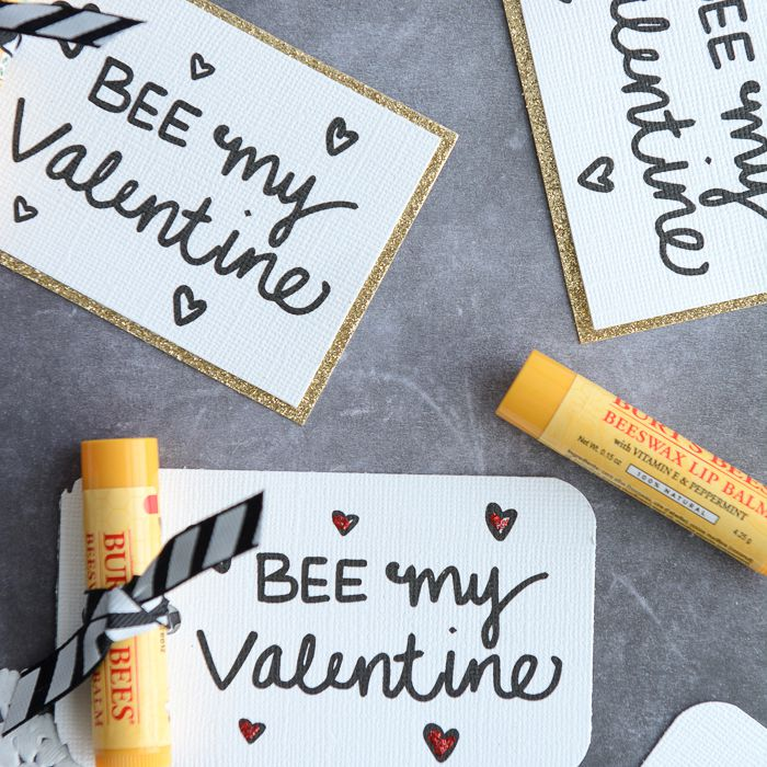 Valentines and chapstick laying on a table