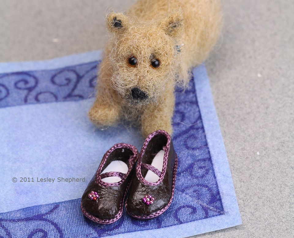 Doll shoes shown with a miniature felted Norwich terrier.