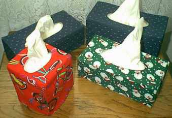 Tissue boxes with custom covers