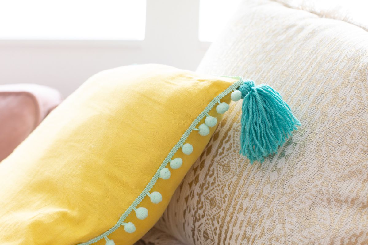 DIY pillow with tassels and trim