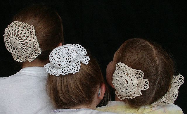 Girly wearing bun covers made from doilys