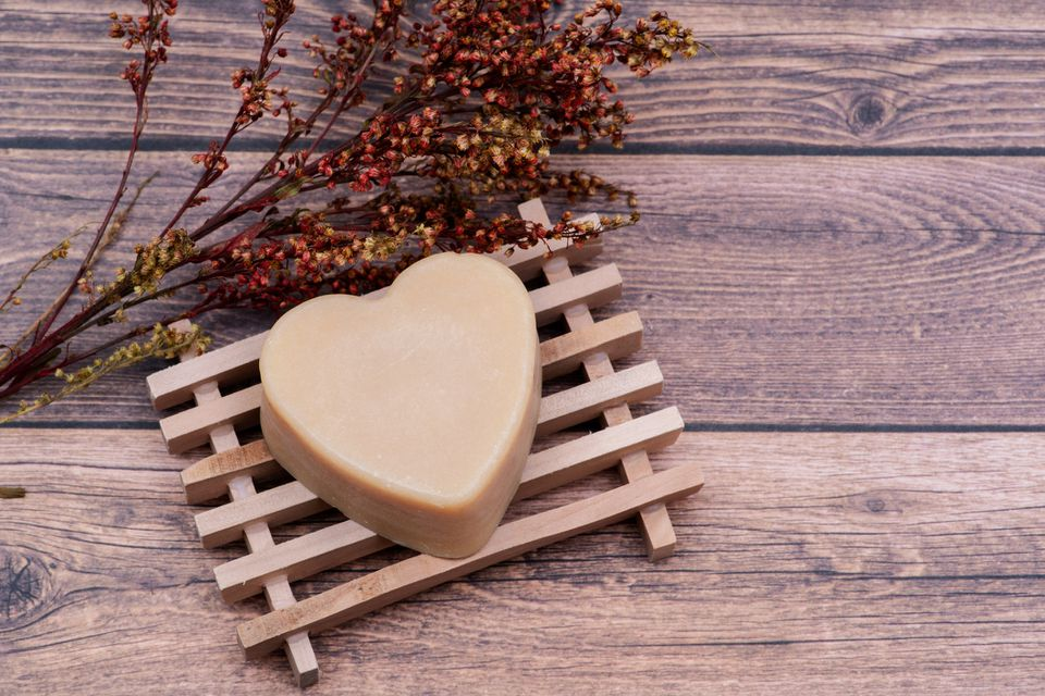 Wooden Soap Holder with a Heart shaped Goat milk Soap on wood