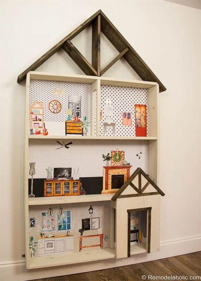 A dollhouse glued to a wall