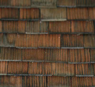 1:12 scale cedar shingles made into a dollhouse roof.
