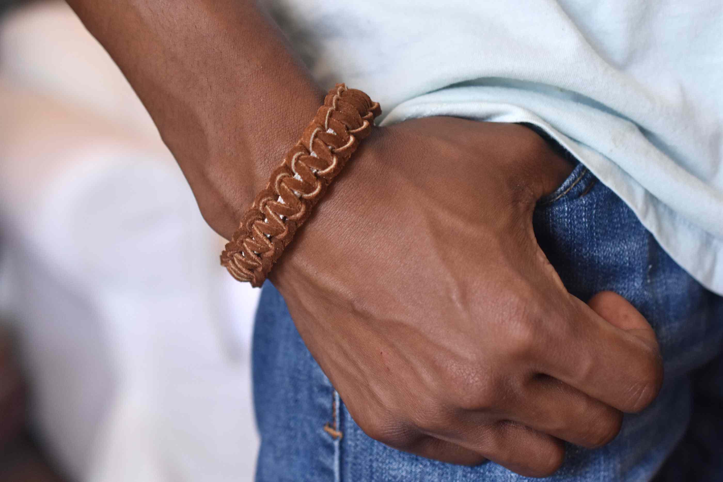 Young Man Wearing a Cobra Stitch Leather Bracelet