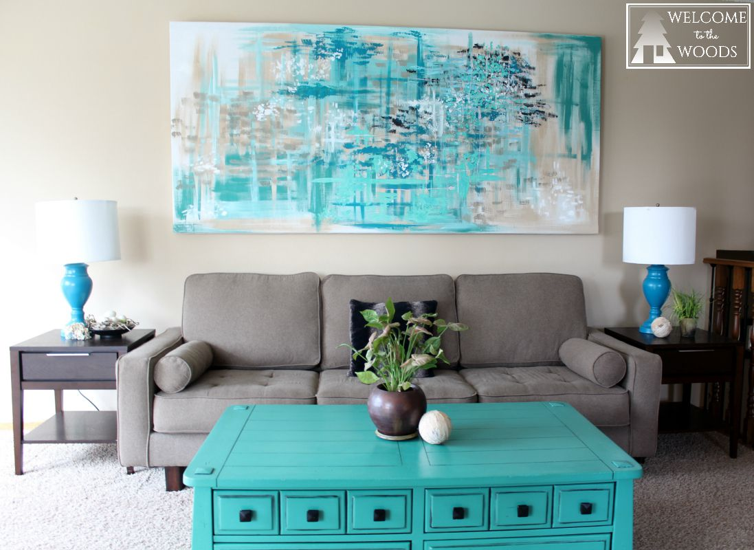 Large statement wall art over couch.