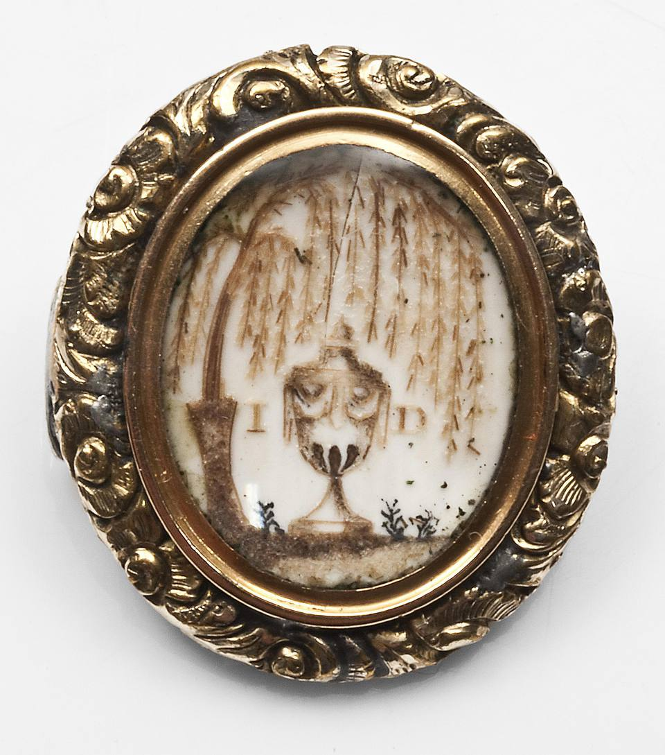 Pre-Victorian crushed hair/painted sepia mourning brooch with Rococo border, painted on ivory, c.1780.