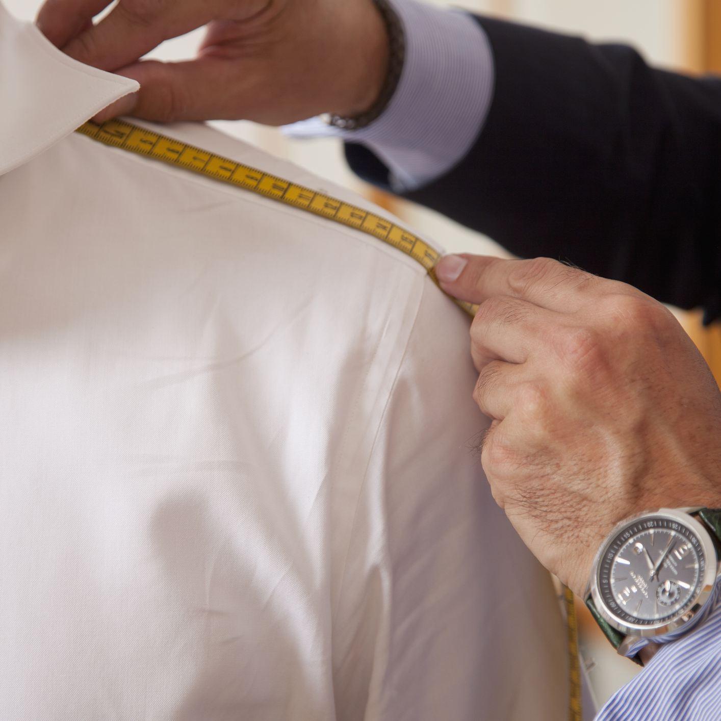 Tailor measuring shoulder