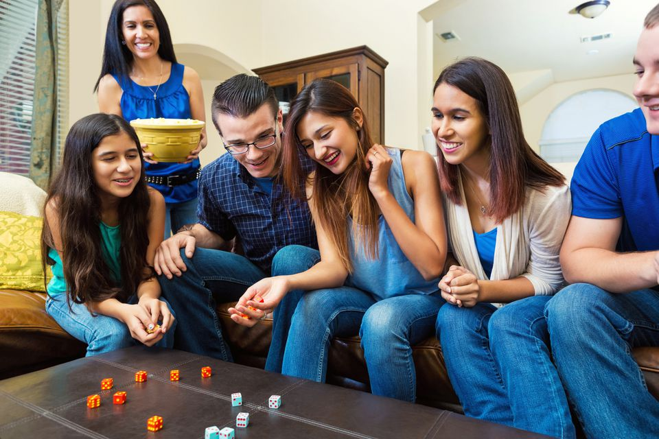 Family playing a rolling dice game