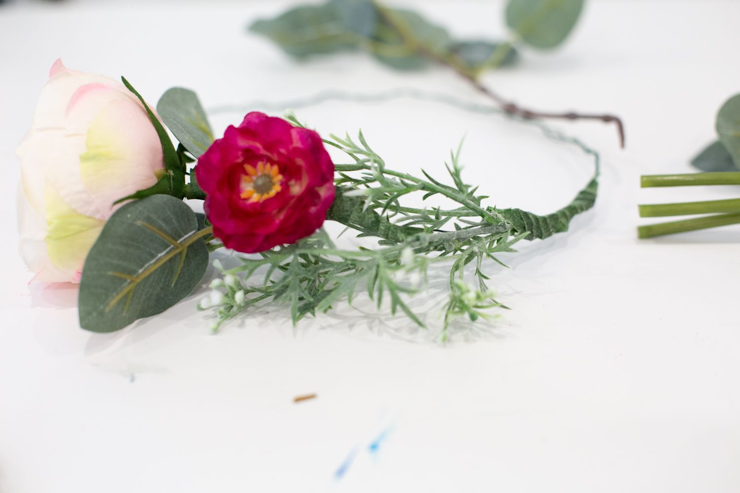 Flowers and filler on a DIY faux flower crown