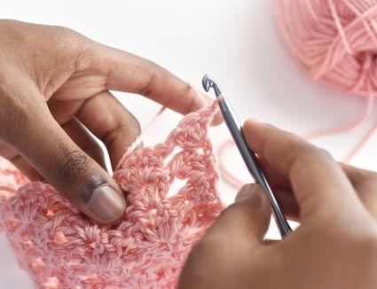 Hands Crocheting V-Stitch Shells