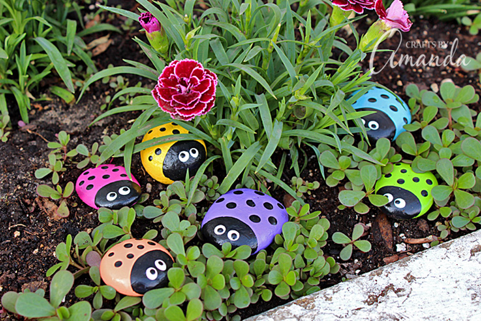Painted ladybug rocks in a garden