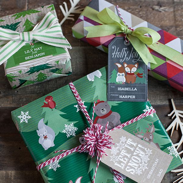 A group of gifts with Christmas tags on them.