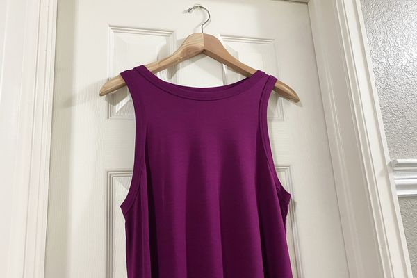A purple dress hanging on a door