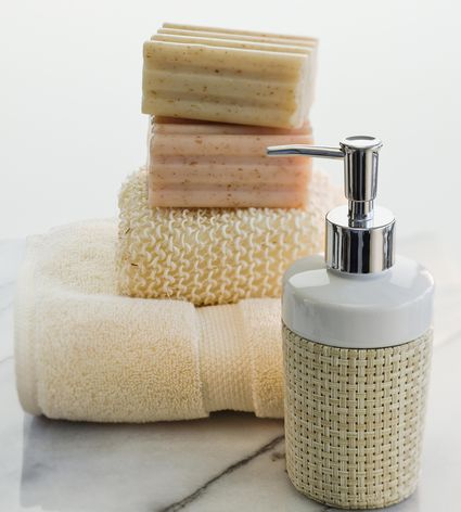 Stack of soap and towels next to lotion