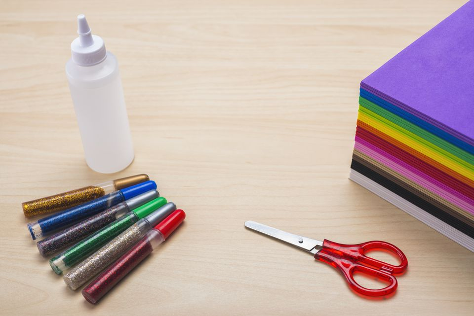 Crafting with colorful foam sheets, glue, scissors and glitter pens
