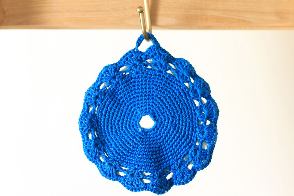 Pretty Vintage Hand-Crocheted Blue Potholder Hanging from Hook